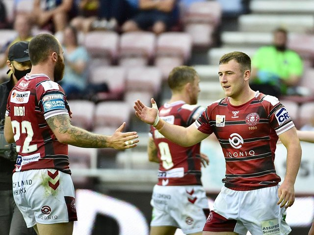 Harry Smith celebrates his try which put Wigan in front