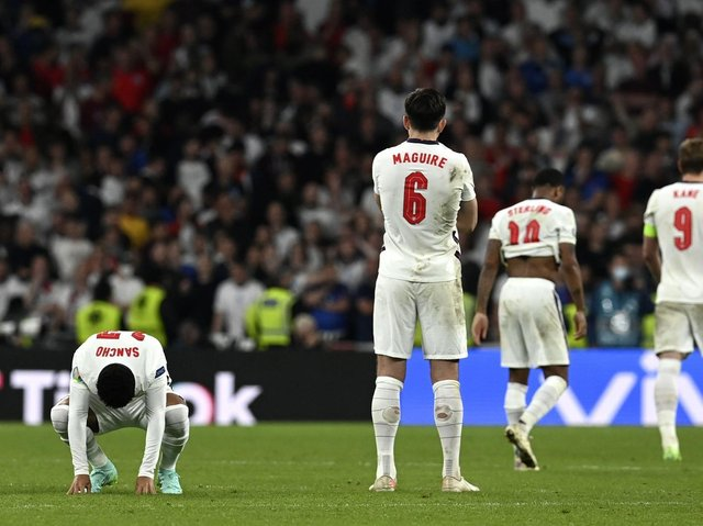 England's dejected players at the end of the Euro 2020 final at Wembley