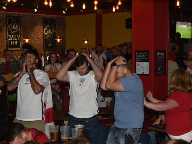 Not our night - fans in Wigan react to the penalty shoot-out in the Euros final