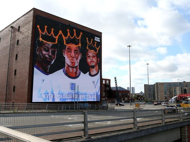 A Giant mural in support of the three England footballers Marcus Rashford, Jadon Sancho and Bukayo Saka has been unveiled in Manchester