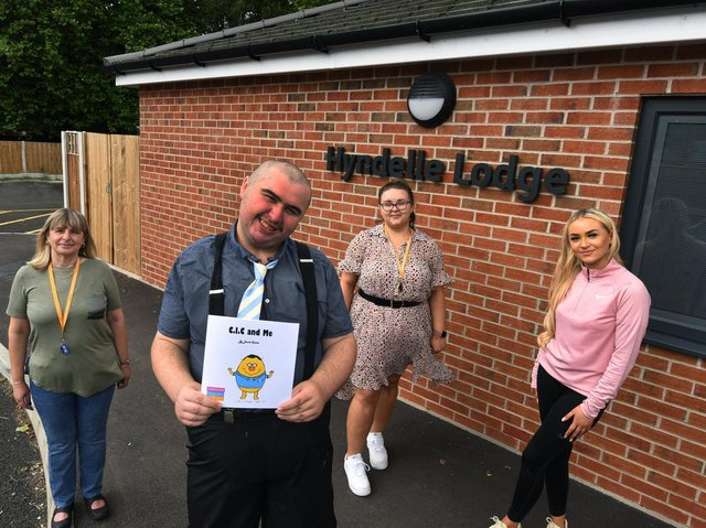 David Clarke a resident at Hyndelle Lodge supported living, Hindley, was struggling with reading but with the help of staff he has now written a book. David pictured with support workers Gill Melling, left, Kayleigh McGarrigan and Ellie Nugent, right