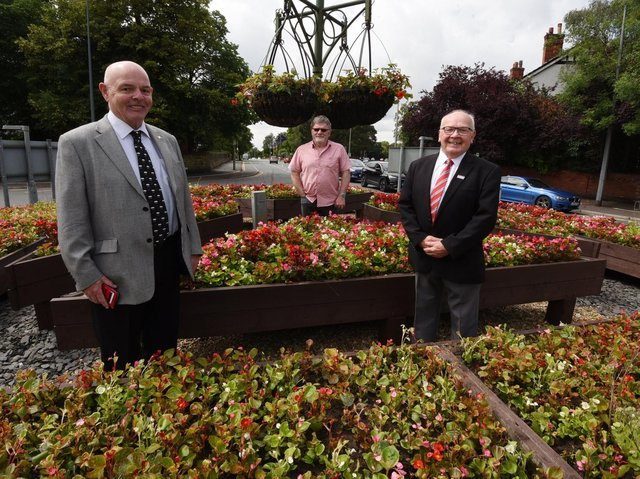 Wigan Councillors Michael McLoughlin, left, and George Davies, right, with local resident Dave Calder at the Cherry Gardens roundabout