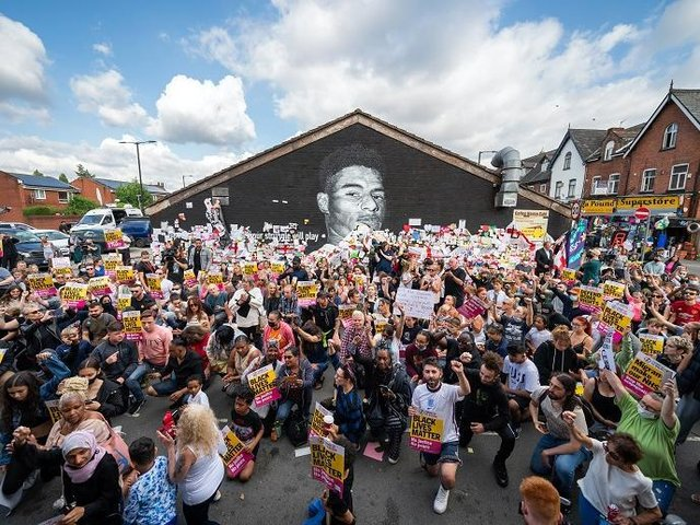 Police have said they do not think that abusive graffiti on the mural was of a racial nature