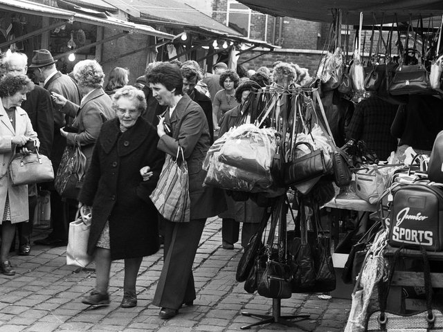 Customers have a look around Ashton market stalls in 1979