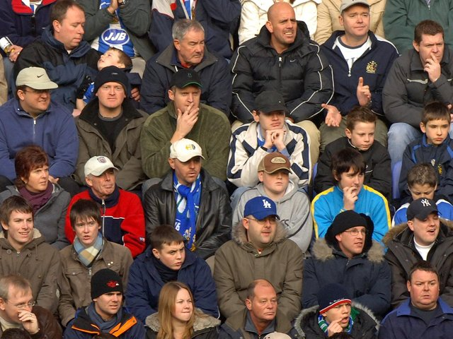 Fans watch Wigan Athletic v Arsenal in November 2005