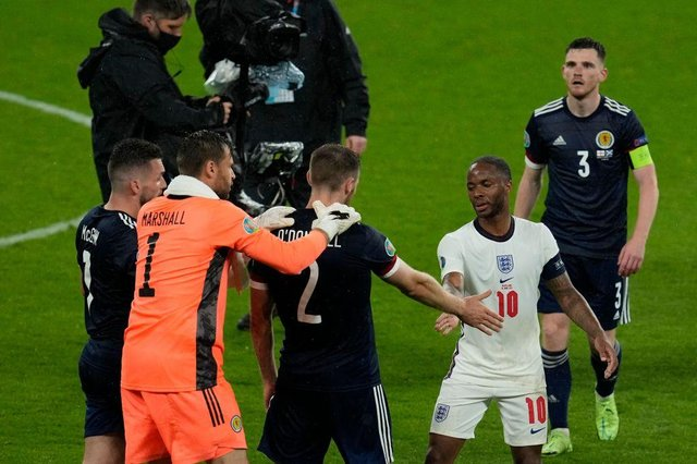 Scotland's defender Stephen O'Donnell shakes hands with England's forward Raheem Sterling after the Group D draw between England and Scotland at Wembley Stadium.