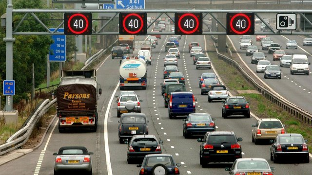 Motorists drive on the hard shoulder of one of the busiest stretches of motorway in Britain between junctions 3 and 7 of the M42